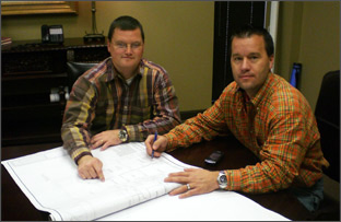 Jackson Construction employees with blueprints